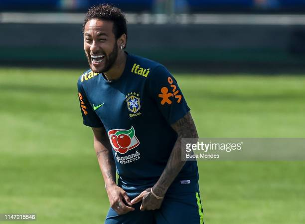 Neymar Jr smiles during a training session of the Brazilian national football team at the squad's Granja Comary training complex on June 01 2019 in...