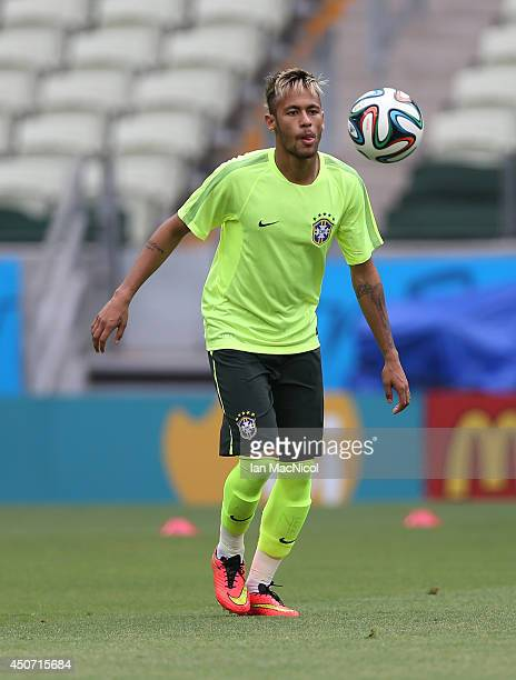 Neymar JR takes part in a training session prior to the Group D match of the 2014 World Cup between Brazil and Mexico at Castelao Stadium on June 16...