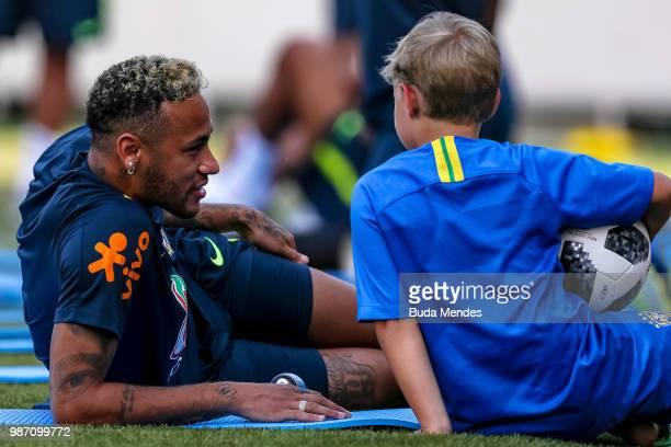 Neymar Jr talks to his son Davi Lucca da Silva Santos during a Brazil training session on June 29, 2018 in Sochi, Russia.