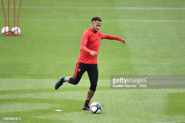Neymar Jr warms up during a Paris SaintGermain training session at Centre Ooredoo on September 13 2018 in Paris France
