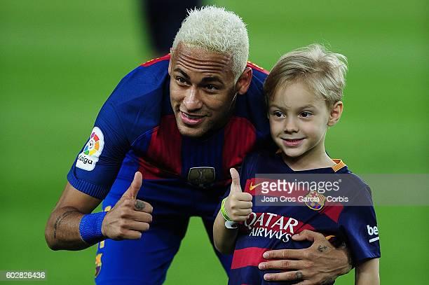 Neymar Jr. With his son, Davi Lucca da Silva Santos attend the Spanish League match between F.C Barcelona vs Deportivo Alavés at Nou Camp, on...