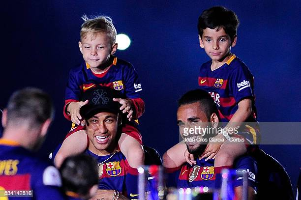 """Neymar Jr, with his son, David Lucca and Douglas Pereira of F.C.Barcelona, celebrating the Spanish League and """"Copa del Rey"""" trophys, May 23, 2016 in..."""