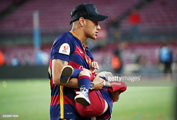 Neymar Jr.with his son during the spanish league and King Cup celebration, held in the Camp Nou, on may 23, 2016.