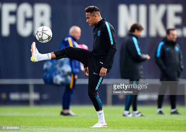 Neymar juggles the ball during a Barcelona training session ahead of their UEFA Champions League quarter final first leg match against Atletico...