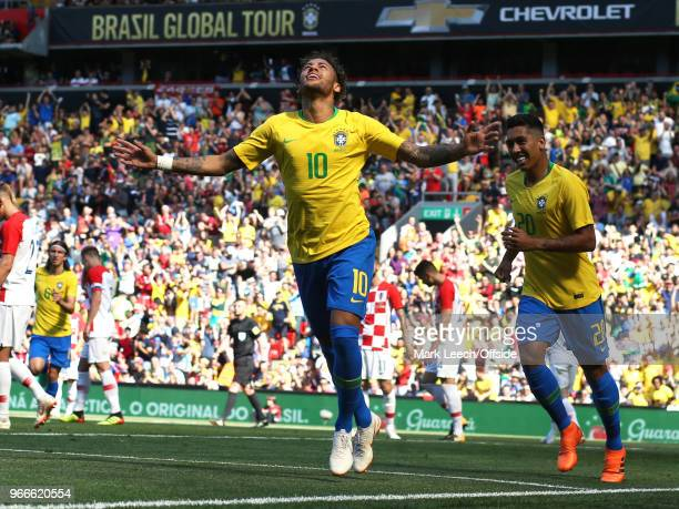 Neymar Junior celebrates his goal for Brazil during the friendly international football match between Brazil and Croatia at Anfield on June 3 2018 in...