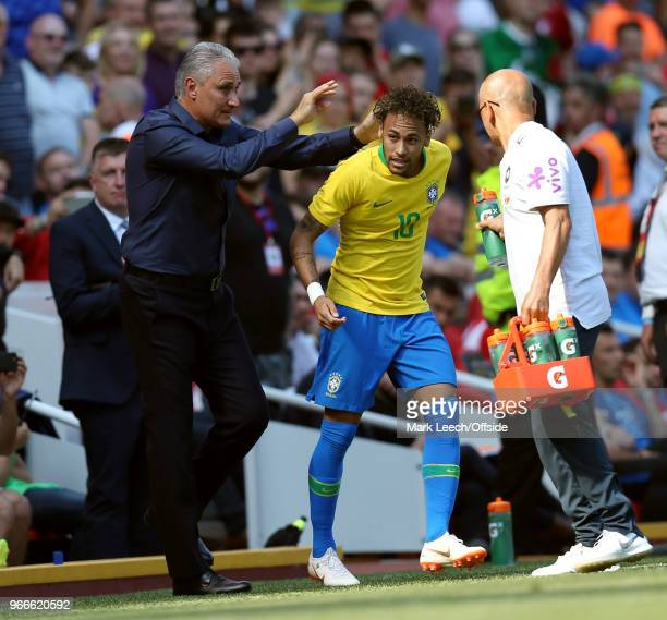 Neymar Junior of Brazil celebrates his goal with coach Tite during the friendly international football match between Brazil and Croatia at Anfield on...