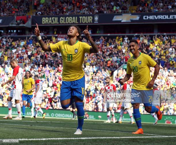 Neymar Junior of Brazil celebrates his goal with Roberto Firmino during the friendly international football match between Brazil and Croatia at...