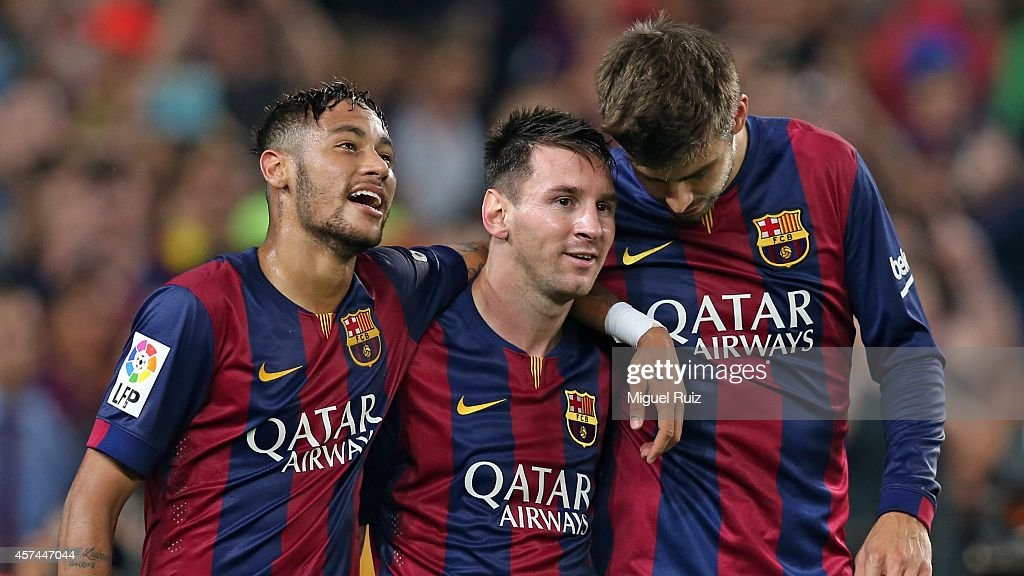 Neymar, Lionel Messi and Gerard Pique of FC Barcelona celebrate the third goal during the La Liga match between FC Barcelona and SD Eibar at Camp Nou on October 18, 2014 in Barcelona, Spain.
