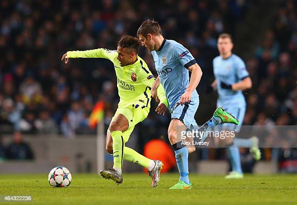Neymar of Barcelona and James Milner of Manchester City battle for the ball during the UEFA Champions League Round of 16 match between Manchester...