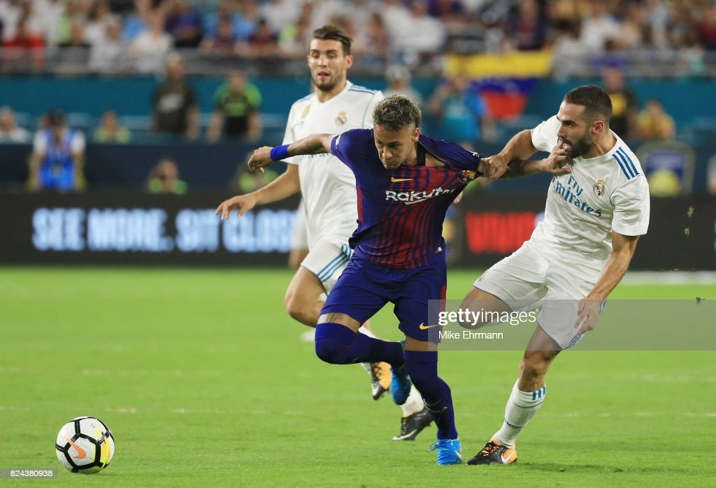 Neymar #11 of Barcelona and Karim Benzema #9 of Real Madrid vie for the ball during their International Champions Cup 2017 match at Hard Rock Stadium on July 29, 2017 in Miami Gardens, Florida.