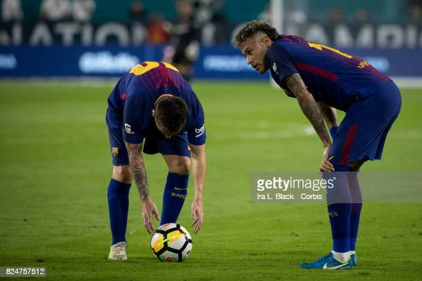 Neymar of Barcelona and Lionel Messi of Barcelona strategize on how to take penalty kick during the International Champions Cup El Clásico match...