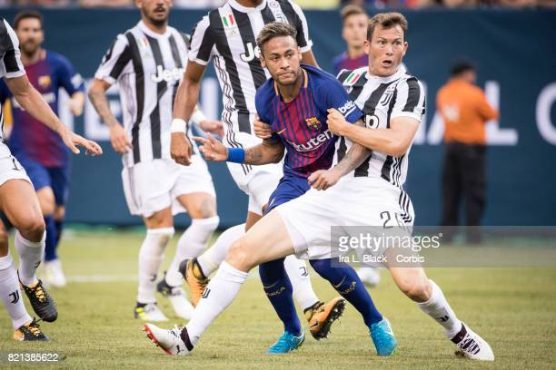 Neymar of Barcelona and Stephan Lichtsteiner of Juventus watch the ball go in during the International Champions Cup match between FC Barcelona and...