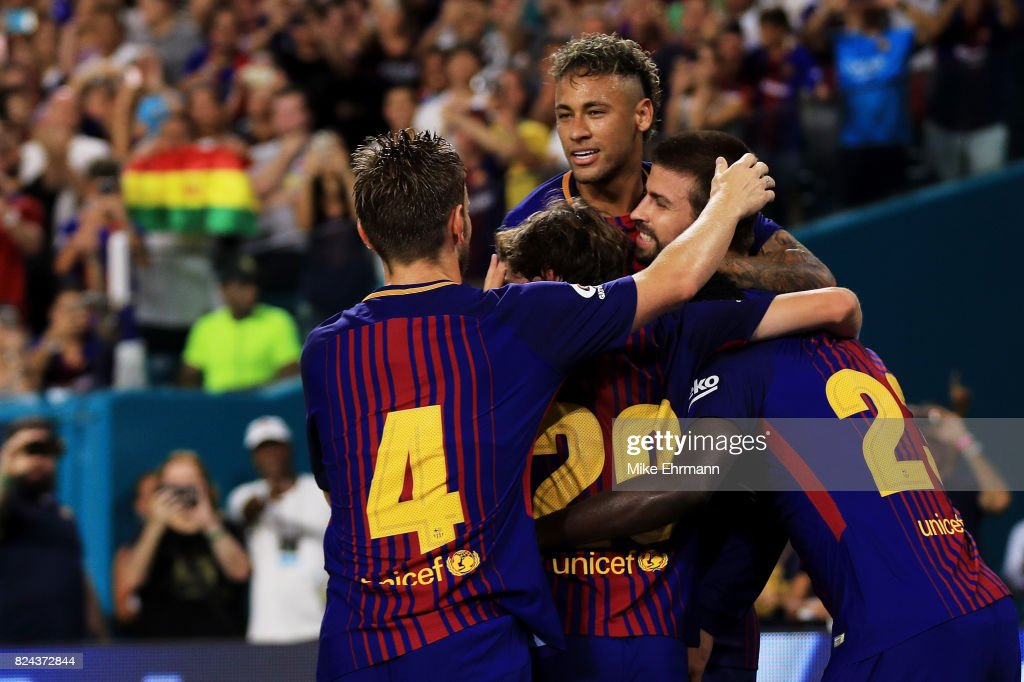 Neymar #11 of Barcelona and teammates celebrate a goal in the second half against Real Madrid during their International Champions Cup 2017 match at Hard Rock Stadium on July 29, 2017 in Miami Gardens, Florida.