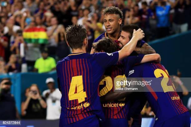 Neymar of Barcelona and teammates celebrate a goal in the second half against Real Madrid during their International Champions Cup 2017 match at Hard...