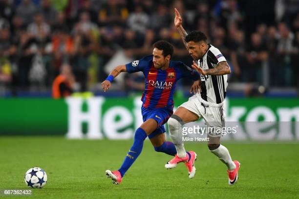 Neymar of Barcelona battles for the ball with Daniel Alves of Juventus during the UEFA Champions League Quarter Final first leg match between...