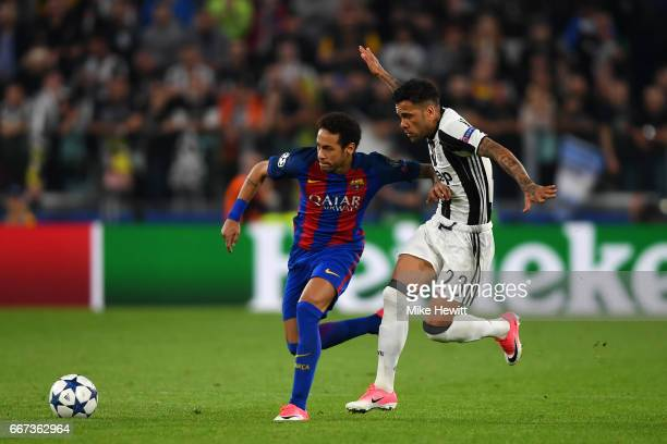 Neymar of Barcelona battles for the ball with Daniel Alves of Juventus during the UEFA Champions League Quarter Final first leg match between...