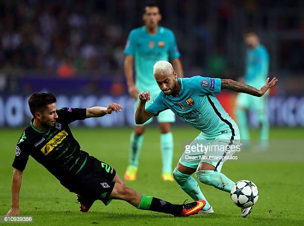 Neymar of Barcelona battles for the ball with Julian Korb of Borussia Moenchengladbach during the UEFA Champions League group C match between VfL...