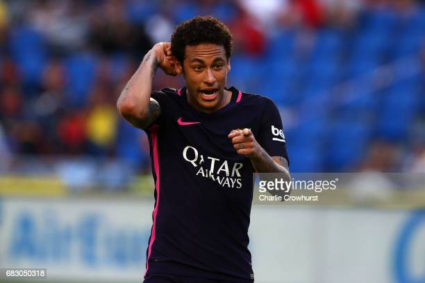 Neymar of Barcelona celebrates by pointing to a tattoo on his arm after scoring his third goal and the teams fourth of the game during the La Liga...