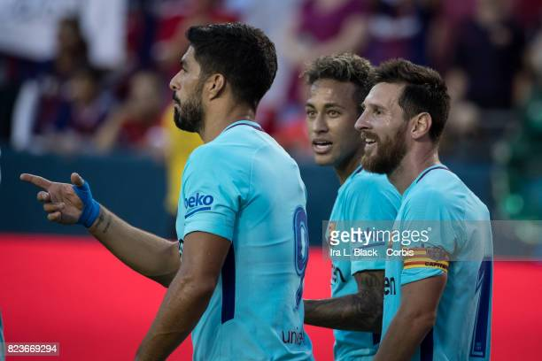 Neymar of Barcelona celebrates his goal with Lionel Messi of Barcelona and Luis Suarez of Barcelona during the International Champions Cup match...