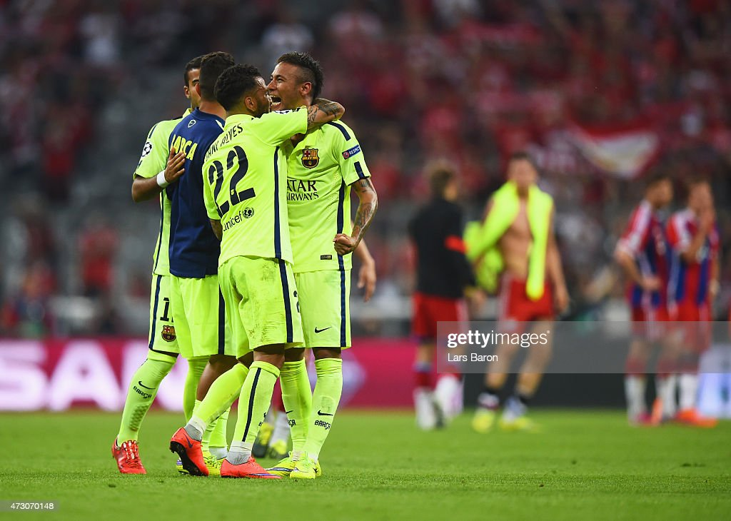 Neymar of Barcelona celebrates reaching the Champions League final with Daniel Alves of Barcelona after the UEFA Champions League semi final second leg match between FC Bayern Muenchen and FC Barcelona at Allianz Arena on May 12, 2015 in Munich, Germany.