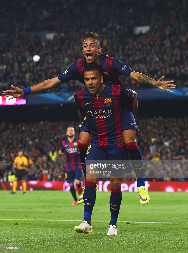Neymar of Barcelona celebrates with Daniel Alves (front) as he scores their second goal during the UEFA Champions League Quarter Final second leg match between FC Barcelona and Paris Saint-Germain at Camp Nou on April 21, 2015 in Barcelona, Spain.