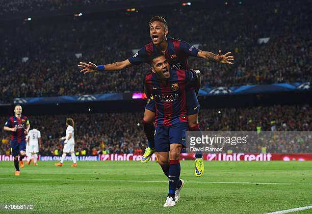 Neymar of Barcelona celebrates with Daniel Alves as he scores their second goal during the UEFA Champions League Quarter Final second leg match...