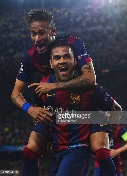 Neymar of Barcelona celebrates with Daniel Alves as he scores their second goal during the UEFA Champions League Quarter Final second leg match...