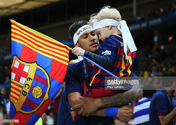 Neymar of Barcelona celebrates with his son David following the UEFA Champions League Final between Juventus and FC Barcelona at Olympiastadion on...