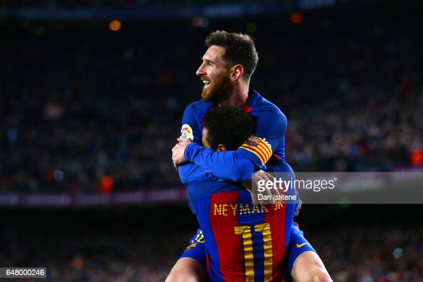 Neymar of Barcelona celebrates with Lionel Messi after scoring their second goal during the La Liga match between FC Barcelona and RC Celta de Vigo...
