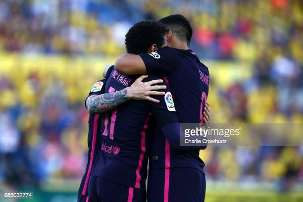 Neymar of Barcelona celebrates with Lionel Messi and Luis Suarez after scoring the first goal of the game during the La Liga match between UD Las...