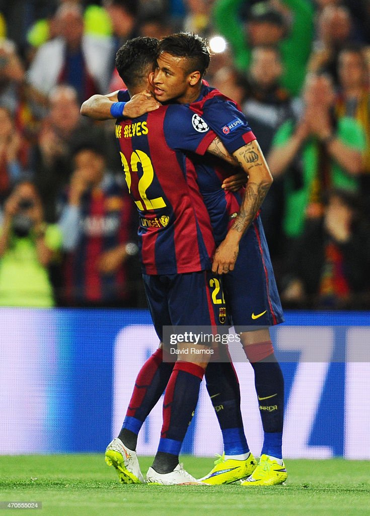 Neymar of Barcelona (R) celebrates with team mate Daniel Alves as he scores their first goal during the UEFA Champions League Quarter Final second leg match between FC Barcelona and Paris Saint-Germain at Camp Nou on April 21, 2015 in Barcelona, Spain.