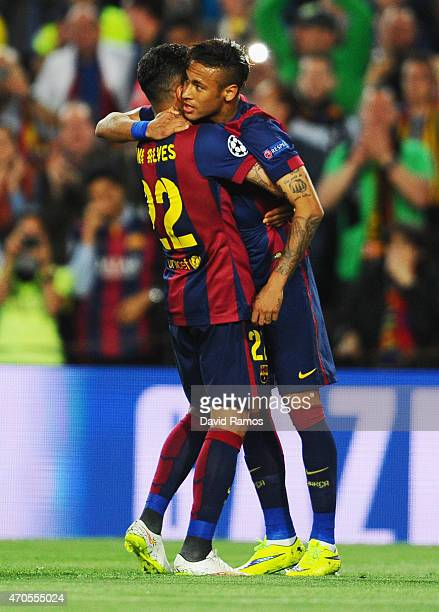 Neymar of Barcelona celebrates with team mate Daniel Alves as he scores their first goal during the UEFA Champions League Quarter Final second leg...
