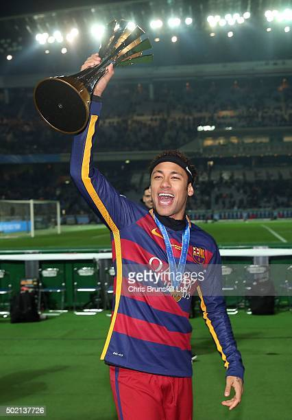 Neymar of Barcelona celebrates with the trophy following the FIFA Club World Cup Final match between River Plate and Barcelona at the International...