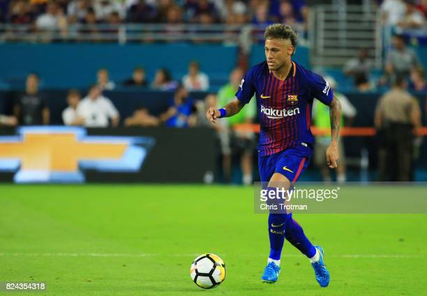 Neymar of Barcelona controls the ball against in the first half against Real Madrid during their International Champions Cup 2017 match at Hard Rock...