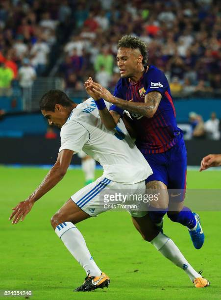 Neymar of Barcelona gets tripped up over Jesus Vallejo of Real Madrid in the first half during their International Champions Cup 2017 match at Hard...