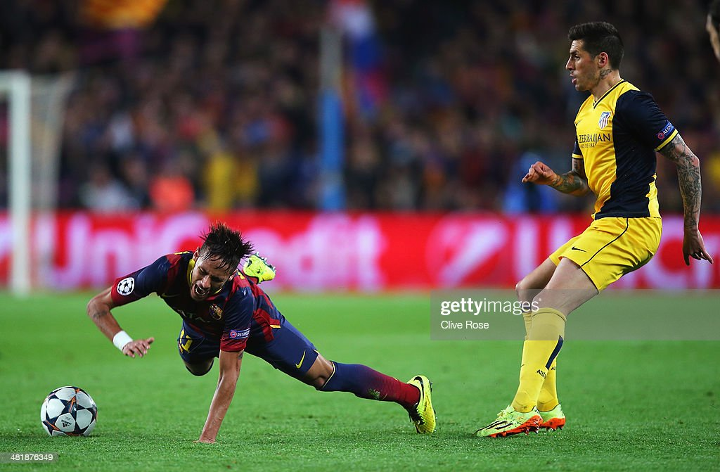 Neymar of Barcelona goes to ground after a challenge by Jose Sosa of Club Atletico de Madrid during the UEFA Champions League Quarter Final first leg match between FC Barcelona and Club Atletico de Madrid at Camp Nou on April 1, 2014 in Barcelona, Spain.