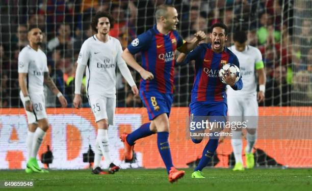 Neymar of Barcelona grabs the match ball as he celebrates an own goal by Layvin Kurzawa of PSG for their second goal during the UEFA Champions League...