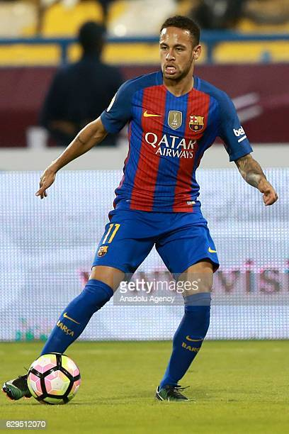 Neymar of Barcelona in action during a friendly soccer match between Al-Ahli Saudi and Barcelona at Al-Gharrafa Stadium in Doha, Qatar on December...