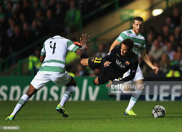 Neymar of Barcelona is challenged by Efe Ambrose of Celtic during the UEFA Champions League Group H match between Celtic and FC Barcelona at Celtic...