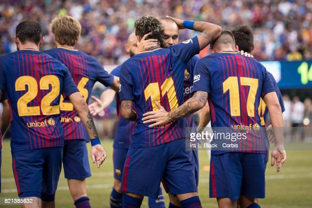 Neymar of Barcelona is congratulated by his teammates Paco Alcacer of Barcelona Andres Iniesta of Barcelona and Aleix Vidal of Barcelona during the...