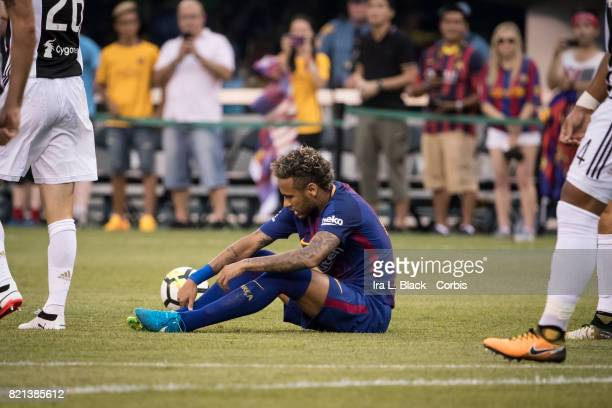 Neymar of Barcelona is down on the ground with from a hit with members of the Juventus team around him during the International Champions Cup match...
