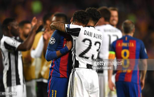 Neymar of Barcelona is embraced by Dani Alves of Juventus after the UEFA Champions League Quarter Final second leg match between FC Barcelona and...