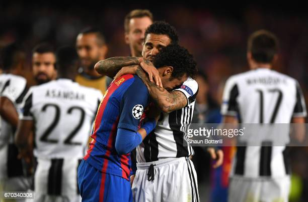 Neymar of Barcelona is embraced by Dani Alves of Juventus during the UEFA Champions League Quarter Final second leg match between FC Barcelona and...