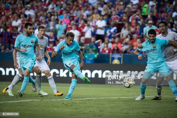 Neymar of Barcelona kicks toward the goal with Lionel Messi of Barcelona and Luis Suarez of Barcelona helping out during the International Champions...