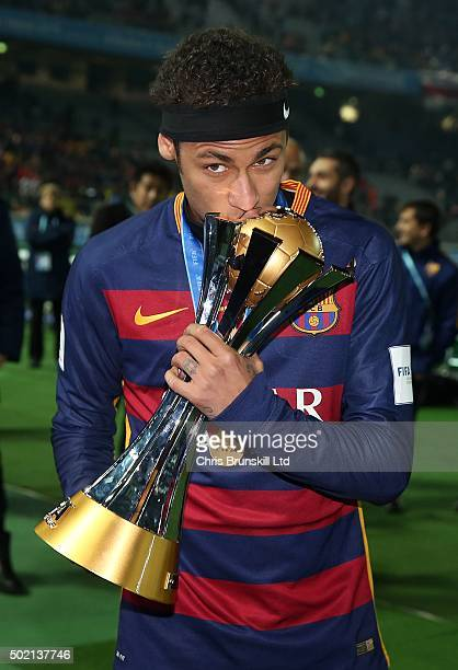 Neymar of Barcelona kisses the trophy following the FIFA Club World Cup Final match between River Plate and Barcelona at the International Stadium...