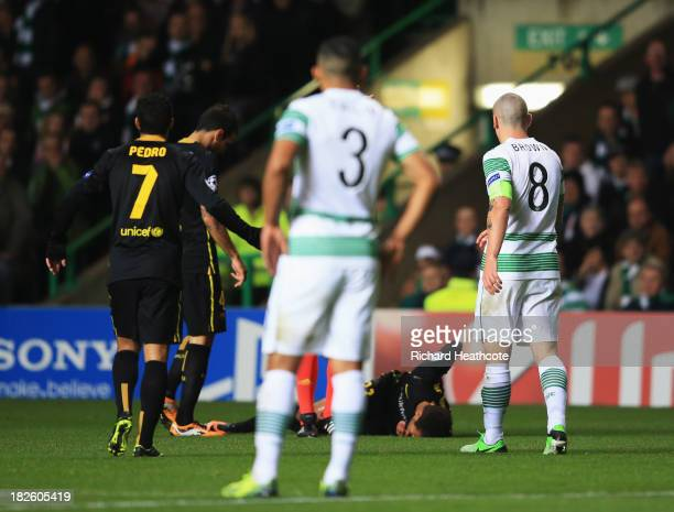 Neymar of Barcelona lays on the ground after a challenge by Scott Brown of Celtic during the UEFA Champions League Group H match between Celtic and...