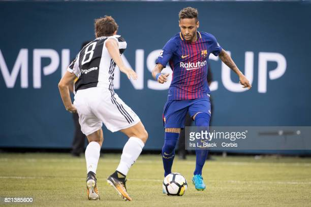 Neymar of Barcelona looks to get past Claudio Marchisio of Juventus during the International Champions Cup match between FC Barcelona and Juventus at...