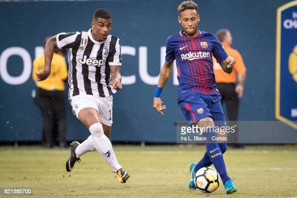 Neymar of Barcelona out runs Mario Lemina of Juventus during the International Champions Cup match between FC Barcelona and Juventus at the MetLife...