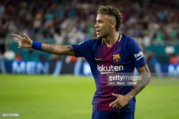 Neymar of Barcelona points to teammate Gerard Pique of Barcelona to celebrate the goal during the International Champions Cup El Clásico match...
