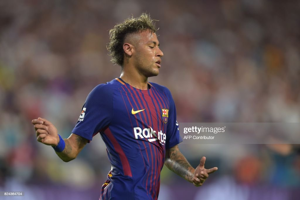 TOPSHOT - Neymar of Barcelona reacts during their International Champions Cup football match at Hard Rock Stadium on July 29, 2017 in Miami, Florida. /